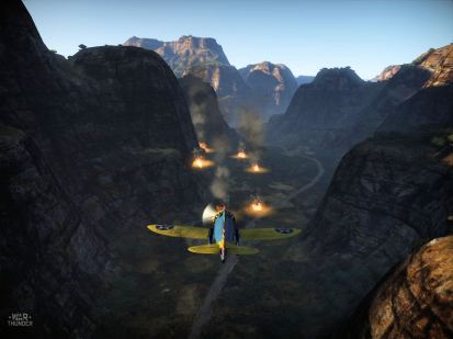 P-26 flying into a canyon of wrecks